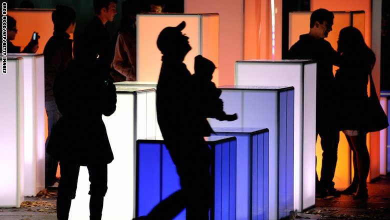 Sydneysiders walk through a light art wo