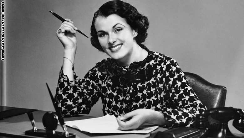 Portrait of businesswoman at desk