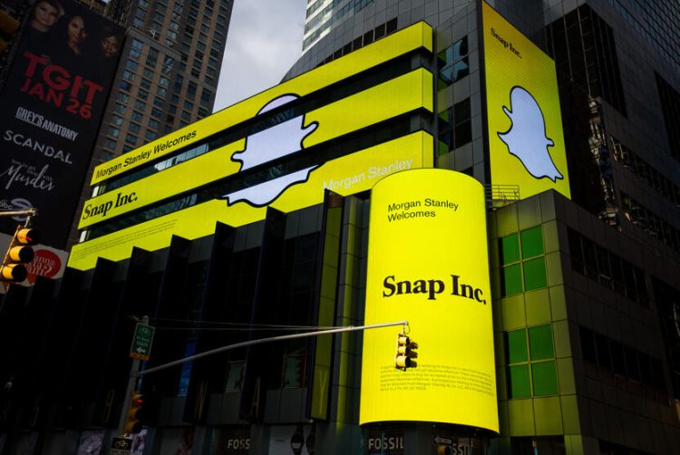 Snap Inc. signage is displayed on screens outside of the Morgan Stanley building in New York, U.S., on Thursday, Feb. 16, 2017. Snap Inc. is seeking to raise as much as $3.2 billion in its initial public offering in what could be the third-biggest technology listing of the past decade. Photographer: Michael Nagle/Bloomberg via Getty Images
